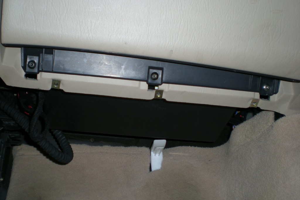 Glove compartment lower mounting screws